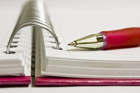 open notebook with pen